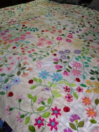 meadow quilt blanket stitch raw edge applique flower leaf vine ladybug bird