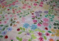 meadow quilt blanket stitch raw edge applique flower leaf vine ladybug bird