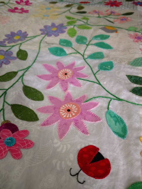 meadow quilt blanket stitch raw edge applique flower leaf vine ladybug